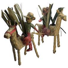 Set of 2 Woven Wicker Farmer Riding Donkey Figurines