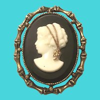 Vintage Gold Tone Brass With White On Black Glass Left Facing Cameo Brooch
