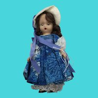 Nancy Ann Hard Plastic Story Book Doll With Closing Eyes & Blue Floral Dress
