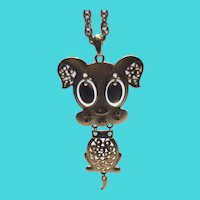 """Sarah Coventry 1975 """"Hercules"""" Gold Tone Puppy Dog Pendant Necklace"""
