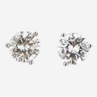 0.75 cwt Diamond Stud Earring in 14 kt White Gold Martini Setting.