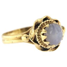 Early 20th Century 14kt Gold Grayish Blue Cabochon Sapphire Ring.
