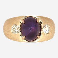 Vintage Natural Star Ruby flanked by European cut Diamond 14 kt Yellow Gold Ring, Circa 1940