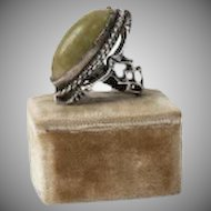 Vintage 1970s silver Mexican elaborate ring with oblong green natural stone size 4.5