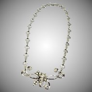 Vintage Sterling Silver and Clear Rhinestone Necklace with Flower Motifs, Signed