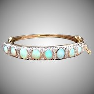 Vintage 1950s Vibrant Opal, diamond, and two tone 14k yellow gold hinged bangle bracelet