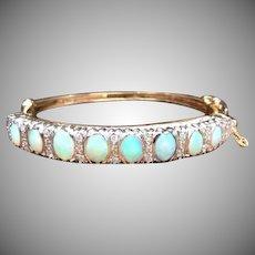 Vintage 1950s Vibrant Opal, diamond, and two tone 14k yellow gold hinged bangle bracelet