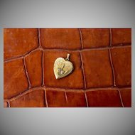 Vintage Victorian gold tone heart shaped locket with Cattail or Club rush pond flowers
