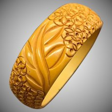 Unique 1940s Carved Yellow Bakelite Bangle Bracelet with Circular Flowers
