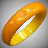 Subtle and Unique 1930s 1940s Carved Butterscotch Yellow Bakelite Bangle with Art Deco appeal