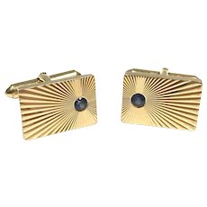 Vintage 1960s 14k solid yellow gold Larter & Sons unisex cufflinks with starburst engraving and bright blue sapphires