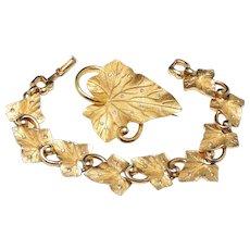 Vintage Pennino signed gold tone leaf bracelet and brooch set