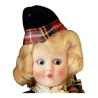 Hard plastic Doll as a Scotch girl in Original Box, 6 inches