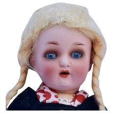 Heubach Koppelsdorf Painted Bisque Girl in Bavarian Costume, 8 inches
