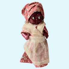 Black Celluloid Doll in colorful red dress and turban, 6 inches