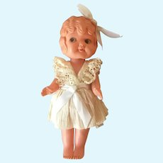 Celluloid carnival kewpie type doll