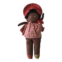 Small brown cloth rag doll