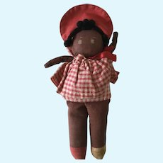Small brown cloth rag doll