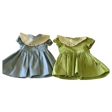 Two commercially made vintage 1950-60's doll dresses