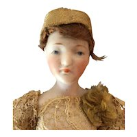 Bisque dollhouse sized flapper doll