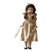 All bisque artisan doll by Cathy Hanson
