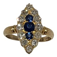 Sapphire and old mine cut diamond marquis shaped cluster ring.