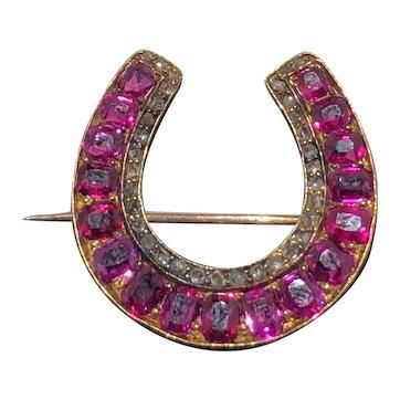 Ruby cushion cut and rose cut diamond Victorian gold horseshoe brooch.