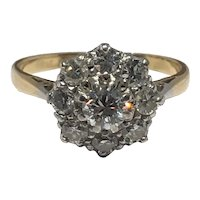 Diamond set cluster ring in 18ct gold and platinum.