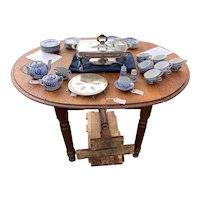 Vintage Oval Golden Oak Drop Leaf Table with Metal Support of end Leaves