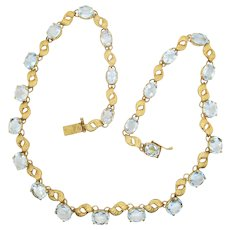 18 Kt. Gold Chain with Aquamarine Settings.