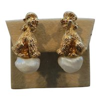 RUSER: rare pair of mid-century 14k yellow gold and pearl dog earrings