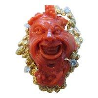 "Unusual carved coral ""Baccus"" brooch"