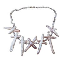 Unique fresh water cultured pearl necklace with cross shaped pearls