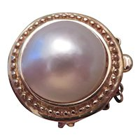14k yellow gold and Mabe pearl clasp