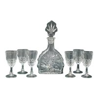 Elegant and gorgeous mid-century vintage crystal decanter with 6 crystal glasses 1950s Made In Italy  Dimensions:  Decanter  4,74 x 2,36 x 9,84 inch  cm 12 x cm 6 x cm 25 H Glasses diameter 1,96 x 4,13 H inch diametro 5 cm x 10,5 H