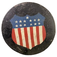Round tin container with American Shield