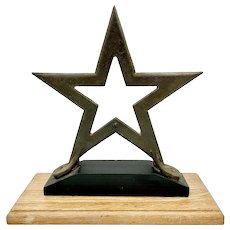 Early 20th century cast iron star element