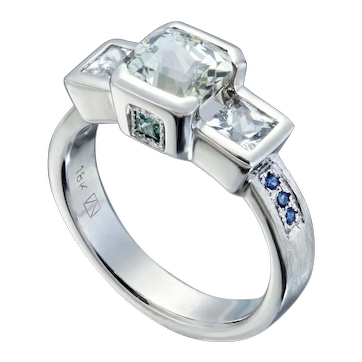 Contemporary 18kt white gold three stone Sapphire ring