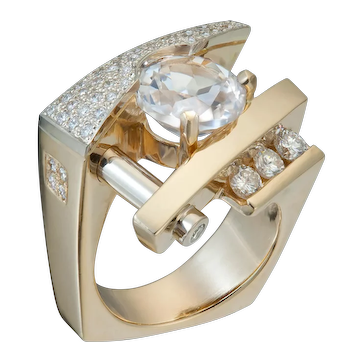 Contemporary 14kt Two-tone Diamond ring with pave and 3ct natural white Topaz
