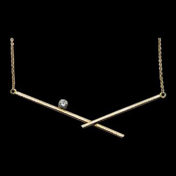 Diamond cross-over bar pendant in 14kt yellow gold
