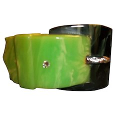Buckle style, hinged green and black bakelite bangle bracelet