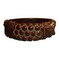Maroon brown hinged and carved bakelite bangle bracelet