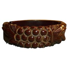 Maroon brown hinged and carved bakelite bangle bracelet