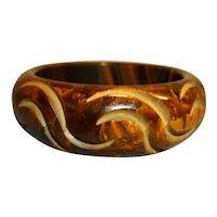 Brown  marbleized carved bakelite bangle