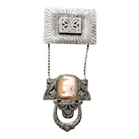 Unusual Sterling silver and marcasite brooch with shell cameo insert