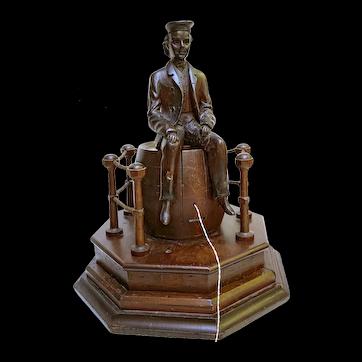 String Jack; Ship Rigger Sitting atop an Upturned Barrel