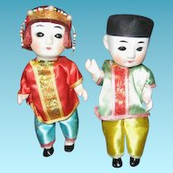 Pair of Oriental Bisque Head Squeak Dolls