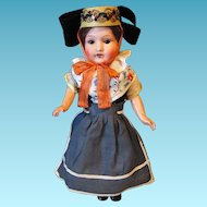 Small A M Bisque Head Composition Doll in European Costume