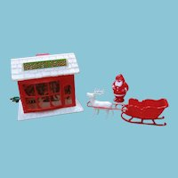 Vintage Plastic Electric Santas Shop and Irwin Red Sleigh with Santa and Reindeer