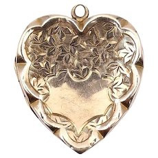 Engraved 9 ct gold locket, an art nouveau heart locket with engraved scroll work.